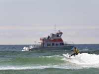 Photo of the Week: Surf Competitor in Cox Bay & Whale Watching Boat, NANUQ