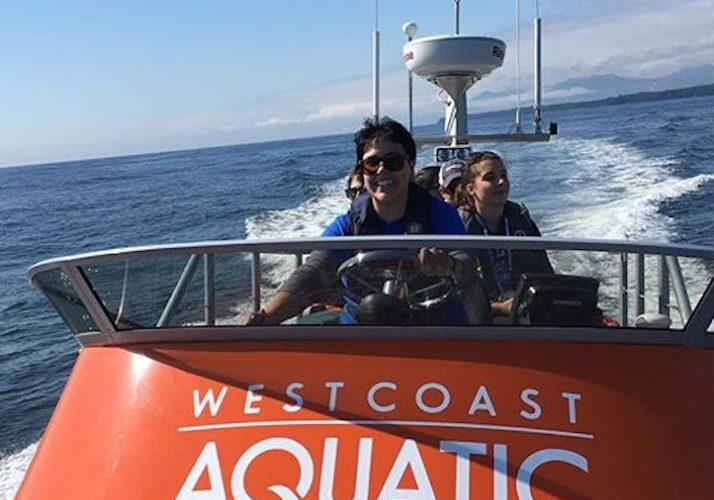 Whale watching tour captain driving boat